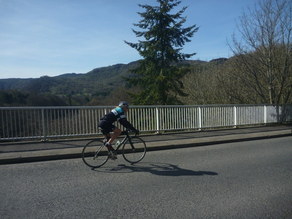 Cyclist riding over Garry Bridge on the Etape Caledonia route